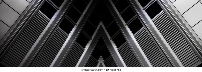 Louvered industrial ceiling. Reworked photo of modern architecture fragment. Abstract black and white interior background.