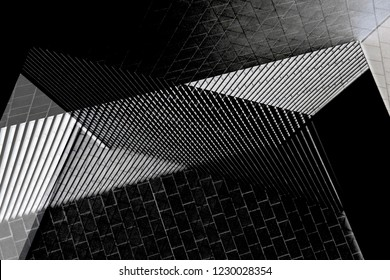 Louvered and tiled walls of industrial or office buildings. Collage photo on the subject of modern architecture. Abstract architectural background in black and white.