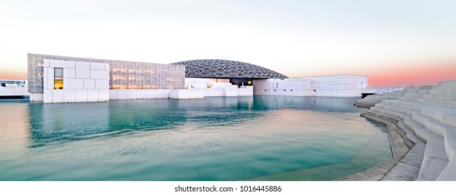 Louvre, Abu Dhabi, United Arab Emirates - Dec.29, 2017: the famous museum of the French architect Jean Nouvel - panoramic view from the tribune at sunrise