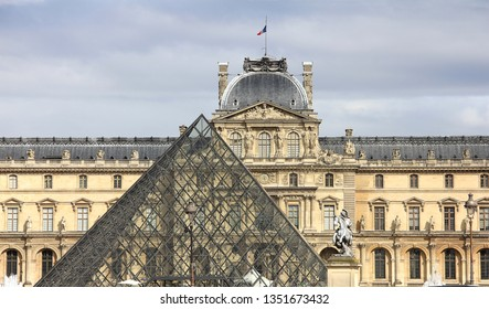Louvre facade with glass triangle france big art museum