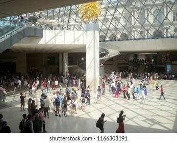 Louvre Museum, Paris, France, August 16 2018: visitors in the hall of the Pyramid