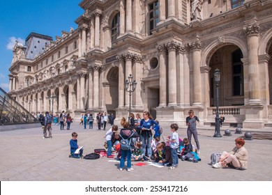 The Louvre Museum, Paris - June 26, 2013 : Teacher and a group of children on a field trip