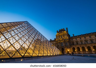 Louvre Museum at twilight time on 9 Apr, 2017. Lourve is the world's largest museums. The glass pyramid as a landmark is in front of the museum.