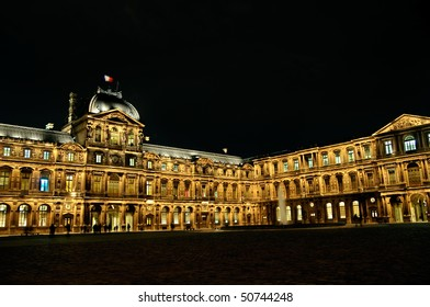 Louvre Palace in Paris at night