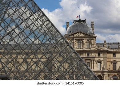 Louvre Palace and triangle glass in Paris.
