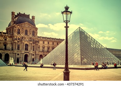 The Louvre in Paris on a sunny day. Vintage view. The Louvre in Paris old retro style.