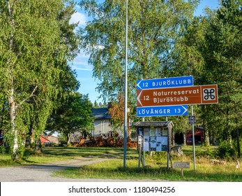 LOVANGER, SWEDEN - AUGUST 9, 2018: Road signs giving directions to Bjuroklubb outside Lovanger in northern Sweden. Bjuroklubb is a nature reserve and a popular area for hiking in county Vasterbotten.