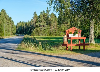 LOVANGER, SWEDEN - AUGUST 9, 2018: Traditional milk churn stand maintained for decorative purposes along a countryroad outside Lovanger in county Vasterbotten in northern Sweden