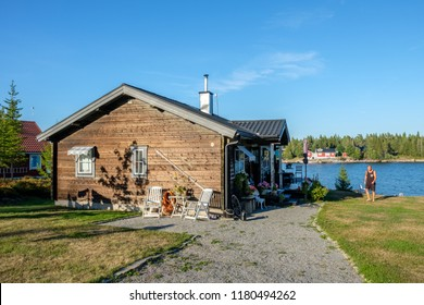 LOVANGER, SWEDEN - AUGUST 9, 2018: Summer day at Sundsviken outside Lovanger in northern Sweden. This is a popular area for summer cottages in county Vasterbotten.