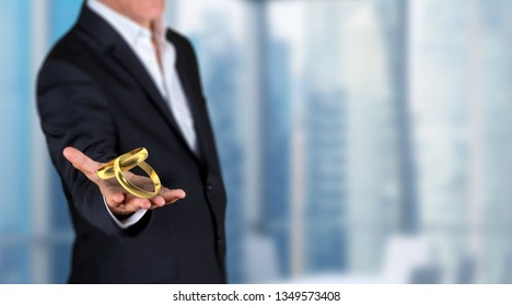 Love affair in office concept, businessman showing 3D render gold engagement rings on his hand in a office. Skycrapers are in background.