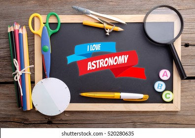 I LOVE ASTRONOMY on chalkboard with school stationery, colorful concept promoting good education.