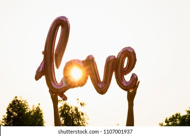 love balloon on blue sky background with flare