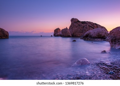 Love beach. Aphrodite's Rock - Aphrodite's birthplace near Paphos City. Cyprus island at sunset