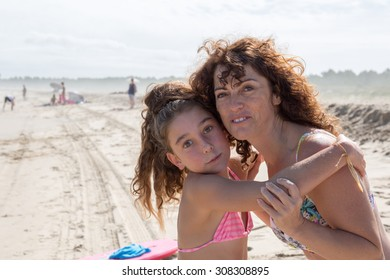Love  between a mother and her daughter at the beach