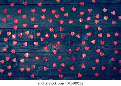 Love black background. Red, glowing hearts on black boards.