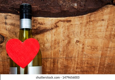 Love for a bottle or a glass of wine on natural, rustic, vintage background - with plenty of empty room for design  / copy / text space.