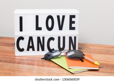 I love Cancun lightbox, sunglasses, notebook and pen, travel concept