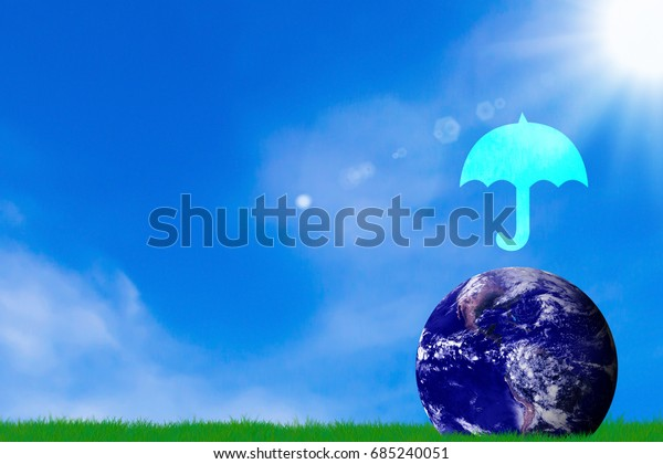 Love and care the earth concept, umbrella icon and blue planet on blue sky background, Elements of this Image Furnished by NASA