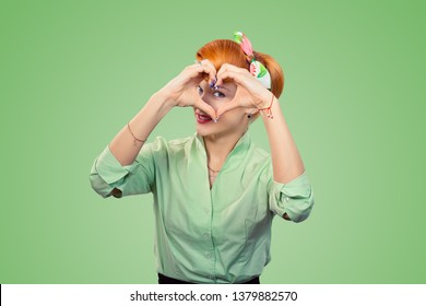 Love. Closeup portrait smiling happy pin up woman making heart sign symbol with hands isolated green wall background. Positive human emotion expression feeling life perception attitude body language