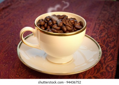 For the love of coffee, coffee beans in a Wedgwood cup and saucer with heart-shaped steam.