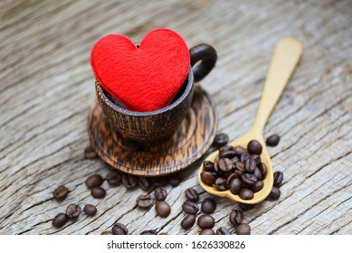 Love coffee concept / Heart in wooden coffee cup with coffee beans romantic love valentines day on wood background