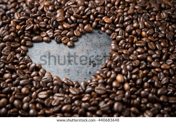 Love coffee, Heart from black coffee beans on dark rustic metal grey background, copy space, frame, top view