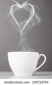 love and coffee. heart silhouette from steaming hot coffee cup