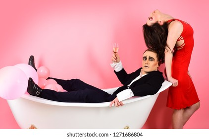 Love comes from love. Couple in love mime enjoy together in bath room. Mime artists. Couple of mime man and sensual woman. A mime show. Telling a love story through body motions. A silent art.