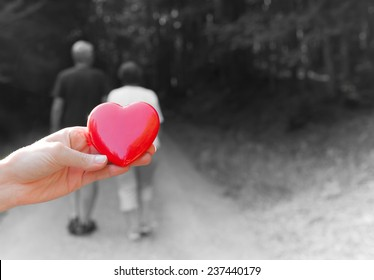 Love concept - Couple holding hands and walking away