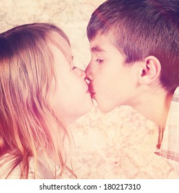 Love concept. Couple of kids loving each other kissing