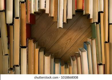 Love concept of heart shape from old vintage books on wooden floor background