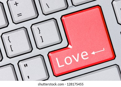 Love concept with message on computer enter key of keyboard