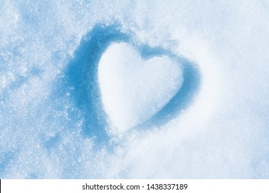 love concept, snow in the shape of heart, valentine day symbol