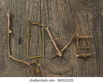 Love concept, word made of dry branches