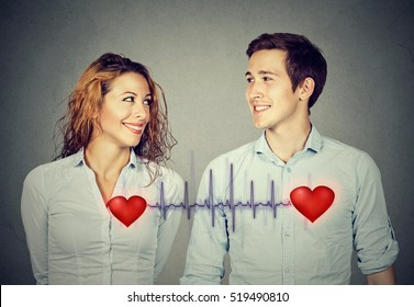 Love connection. Happy man woman looking at each other with red hearts linked by cardiogram