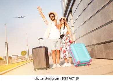 Love couple at the airport says goodbye to a friends and going to vacation, holiday, honeymoon, adventure…