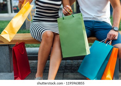Love couple with bright shopping bags with copy space