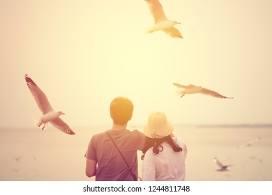 Love couple dating at tropical sea with seagull flying background. vintage filter