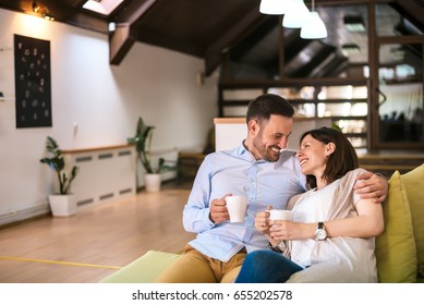 Love couple drinking coffee at home
