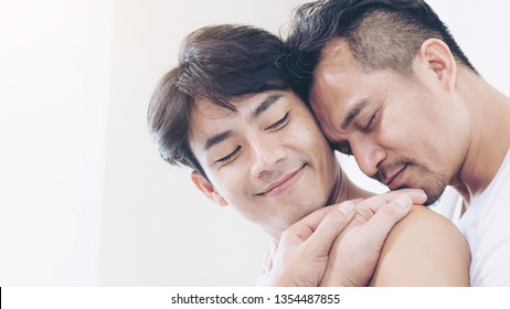 love couple gay homosexual hugging ,  couple man and man relaxing in bed room - Gay Couple Love Home Concept
