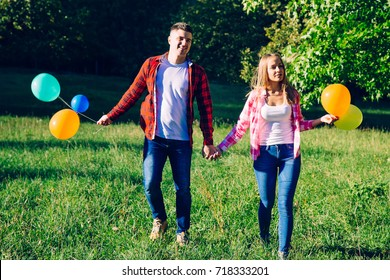 Love couple have fun with a balloon in the park