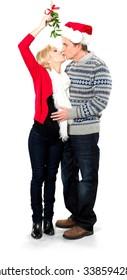 Love Couple Kissing Under The Mistletoe - Isolated