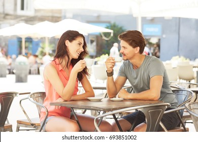 Love couple on a date. Spend time in the cafe. Summer time