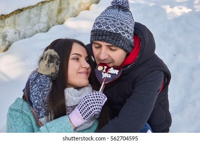 Love couple in park with candy