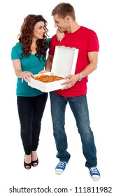 Love couple sharing pizza. Enjoying together. Full length shots