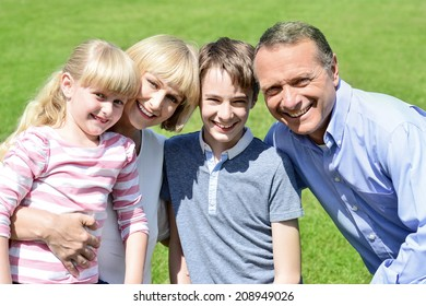 Love couple spending time with their children