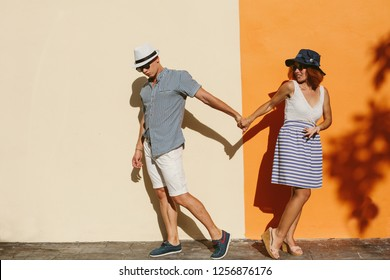 Love couple in Summer travel arguing about way to go. Shopping together. Relationship difficulties