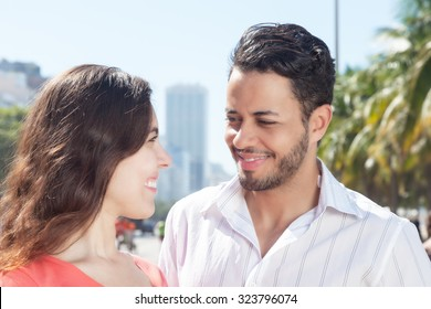 Love couple talking in the city with modern buildings in the background
