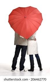 Love Couple united under red heart-umbrella