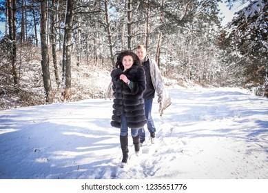 love a couple, walk in winter woods